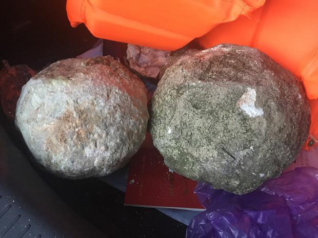 昨天刚捡的圆石,外疏内坚,像恐龙蛋,直径20多厘米.附图,这是什么石头?