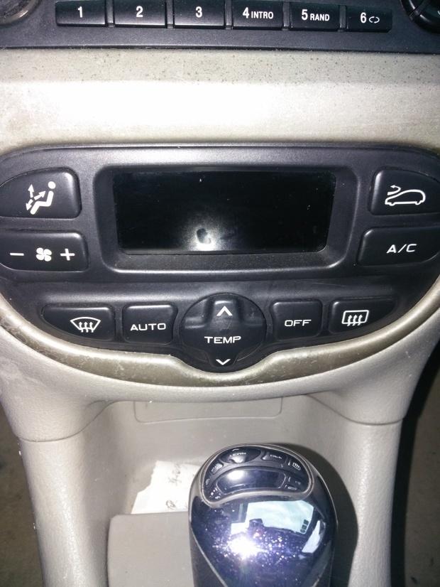 标致206自动那个按键是开热空调的